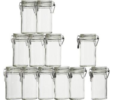 Small Oval Jars: Only about 2.5 inches tall. I just turned these into individual wedding invitations by filling them with dried flowers, ribbon, paper, etc. Many different uses!