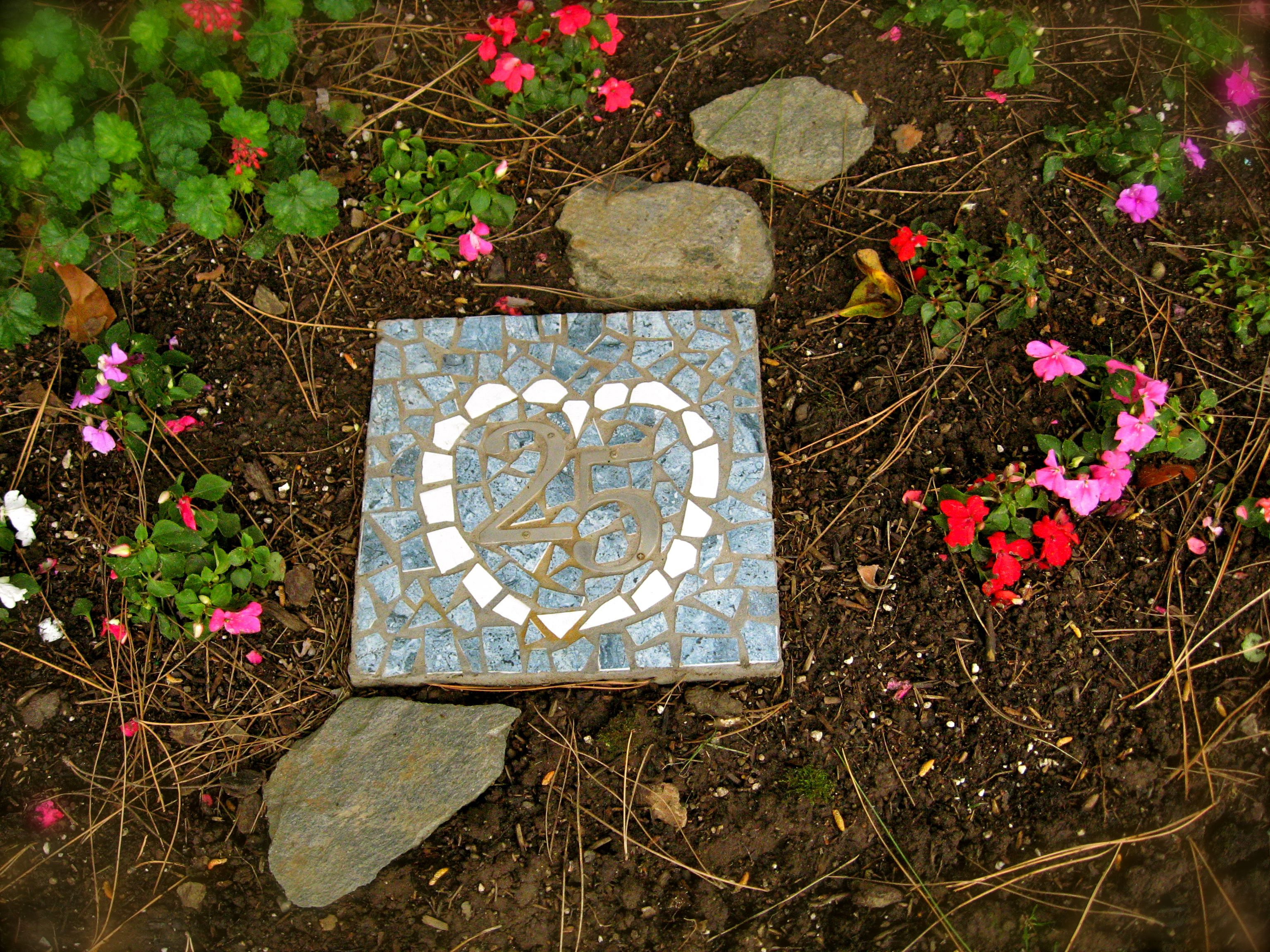 Twenty fifth wedding anniversary celebrated with a tiled garden