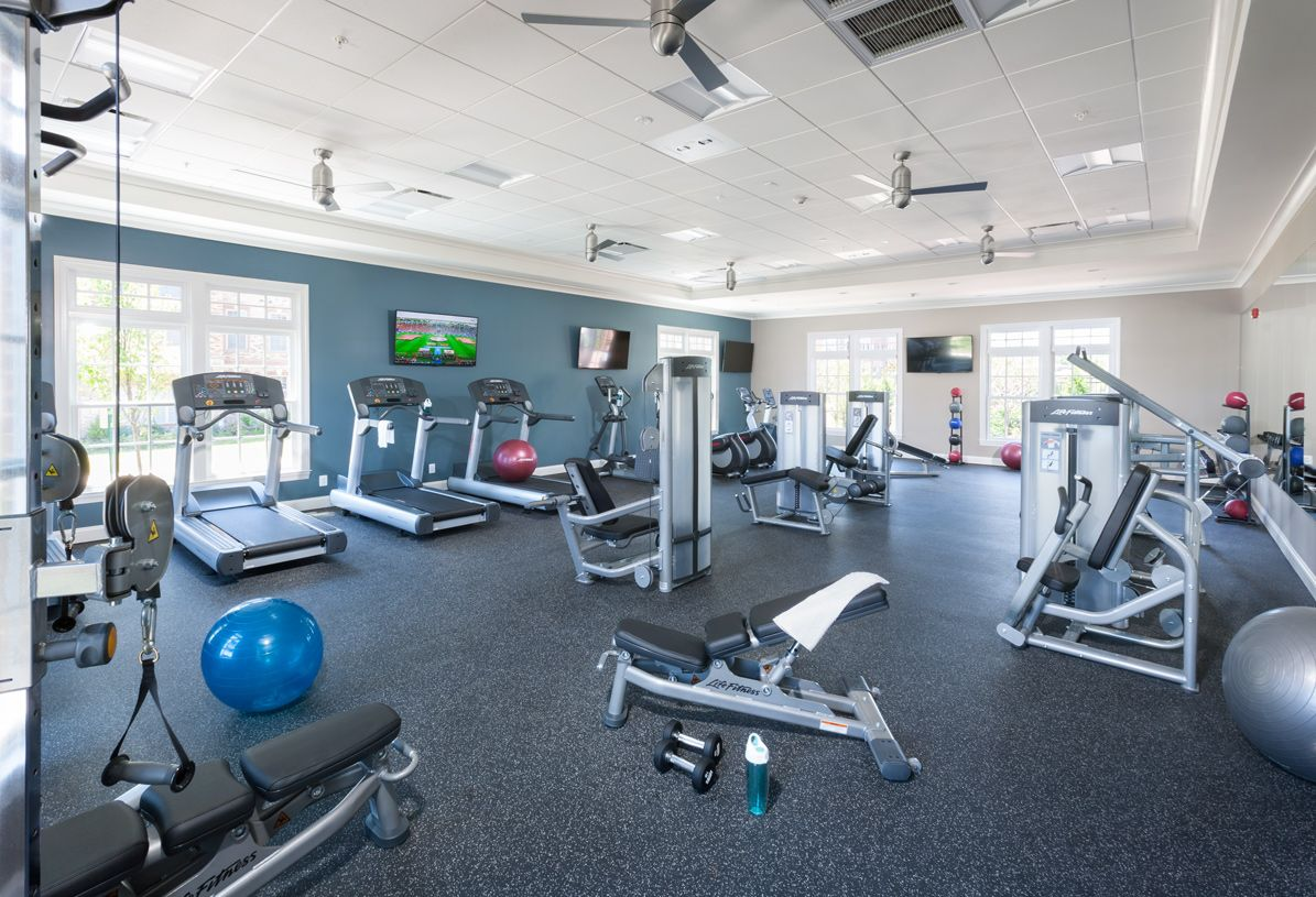 New Homes Loudoun County Get In A Quick Workout Any Time At The Fitness Center With State Of The Art Equipment Home Home Gym Garage Basement Remodeling