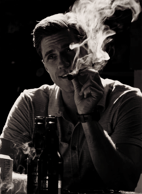 Aaron Tveit smoking a cigarette (or weed)