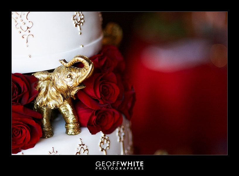 gorgeous indian wedding cakes | Each layer of the cake was separated by these little golden elephants ...