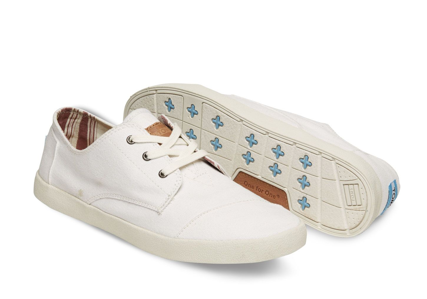 All white TOMS canvas sneakers. The Paseo is our lace up style. Simple look