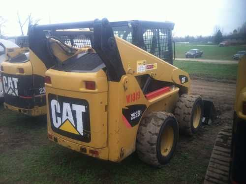 $25,000: 2008 Cat 252B2 Skid Steer Loader, 74 hp, EROPS, heat, auxillary hydraulics, quick coupler, GP bucket, 2004 hours.
