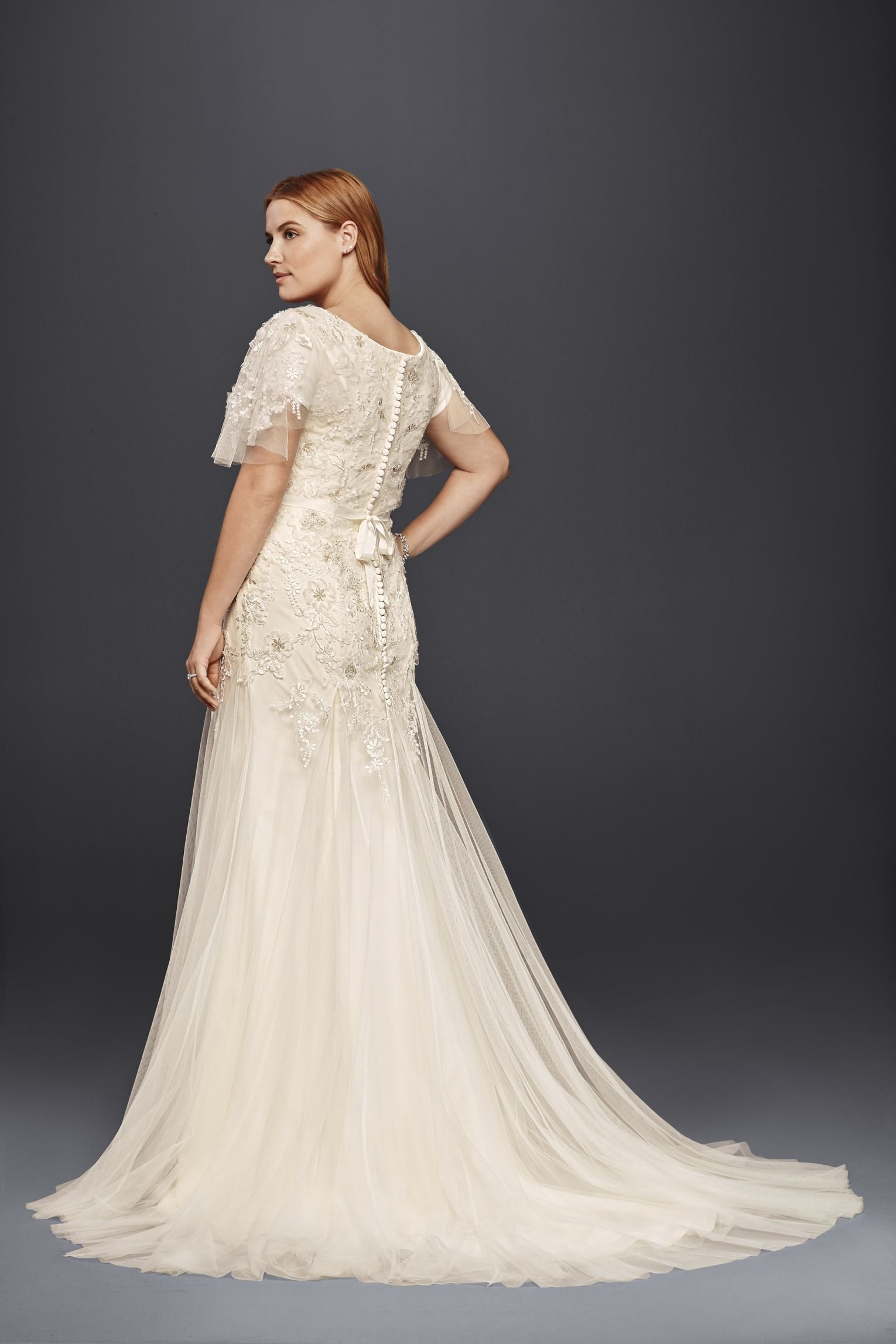 Catholic wedding dresses  Flutter sleeves and romantic florals on this modest wedding dress