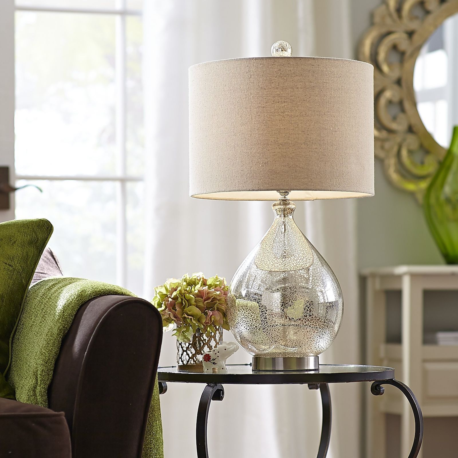 Our mercury glass lamp with a champagne-colored shade is ...