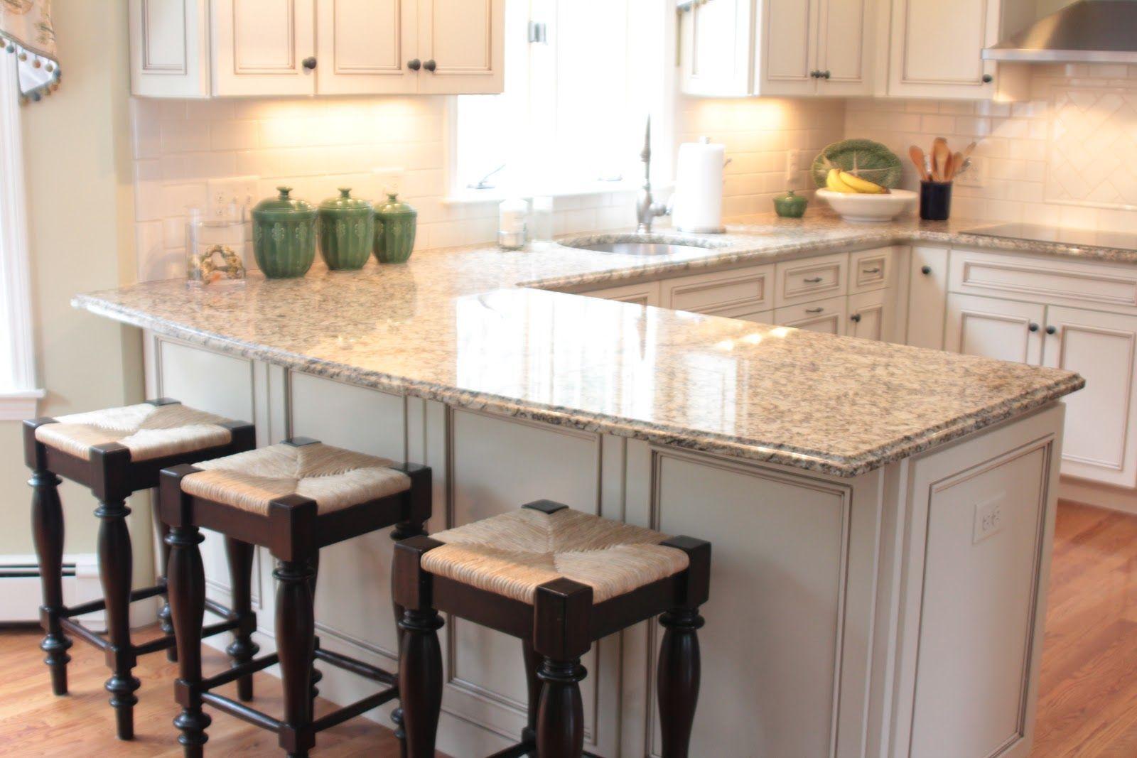 White U Shaped Kitchen With Peninsula