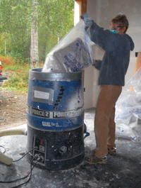 Blowing insulation loading a cellulose insulation blower with a blowing insulation loading a cellulose insulation blower with a bale of cellulose solutioingenieria Choice Image