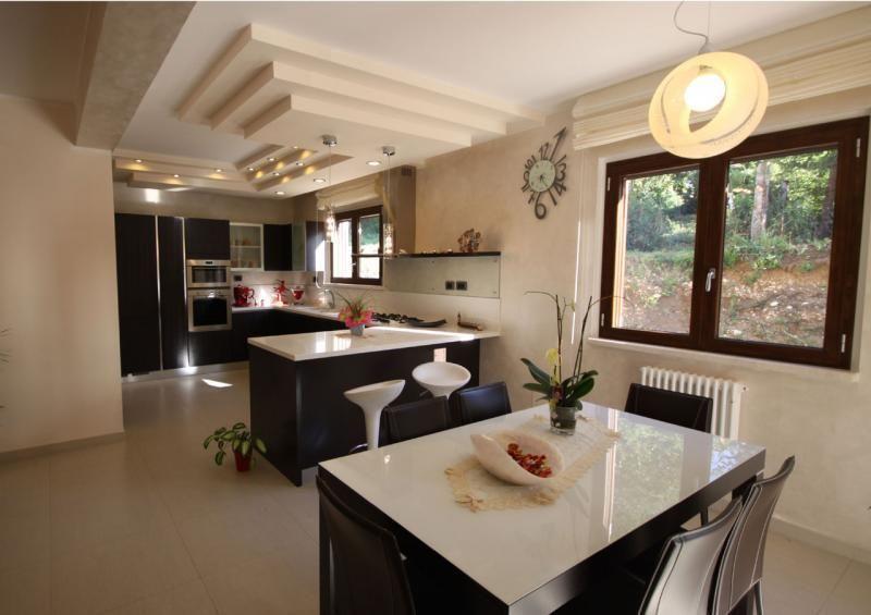 Case e villette in legno l a cost l 39 aquila casa a due for Case e interni