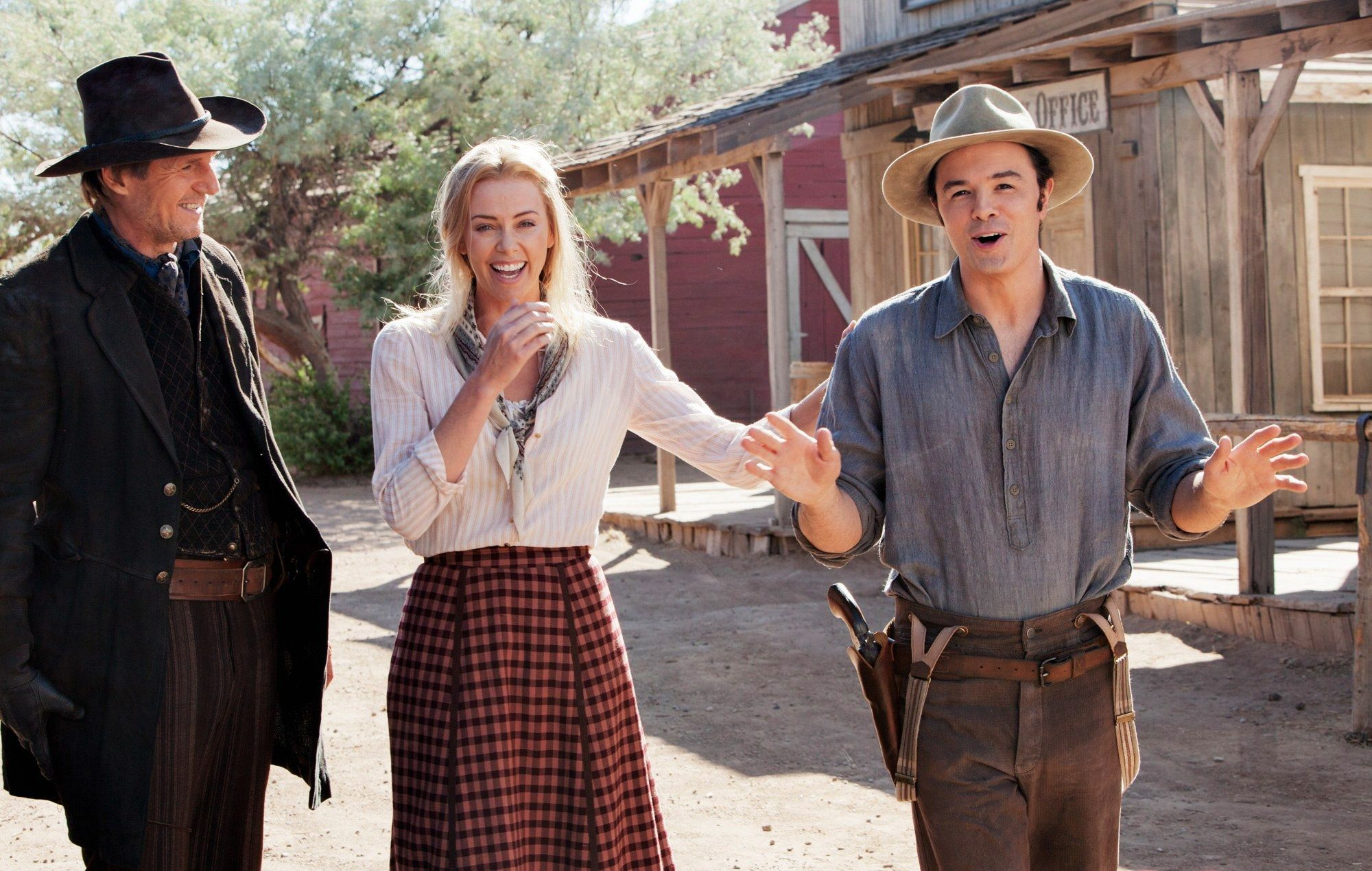 A Million Ways To Die In The West Stream On The Set Of A Million Ways To Die In The West 2014 L To R Liam Neeson Charlize Theron Co Writer Co Producer Liam Neeson Charlize Theron Western Film