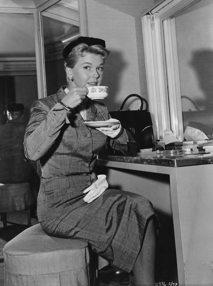 "Doris Day, 1956  ""Doris Day takes a coffee break during the filming of Hitchcock's The Man Who Knew Too Much (1956)"" ~ wearing a 50s SUIT"