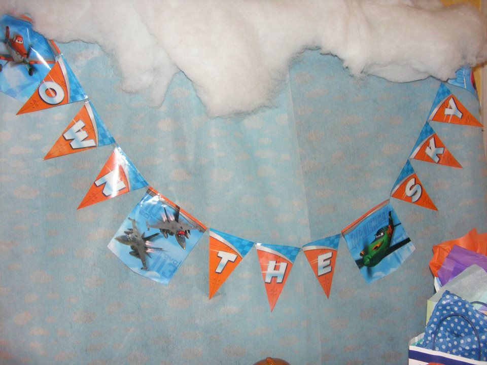 Purchased a small banner with colors to fit our orange & blue color theme from Planes movie. Own The Sky