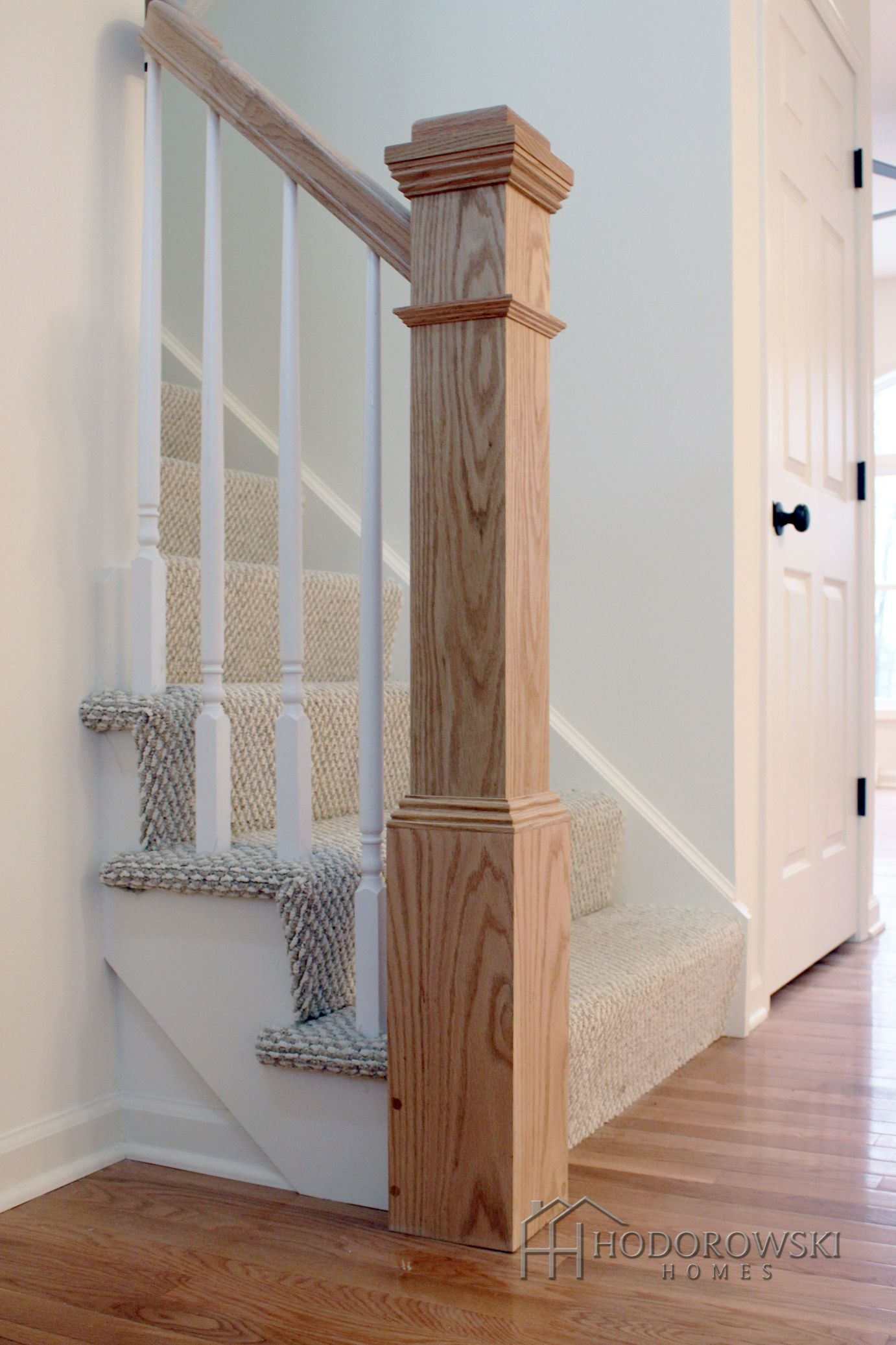 Make A Statement In Your Foyer With A Large Square Newel Post