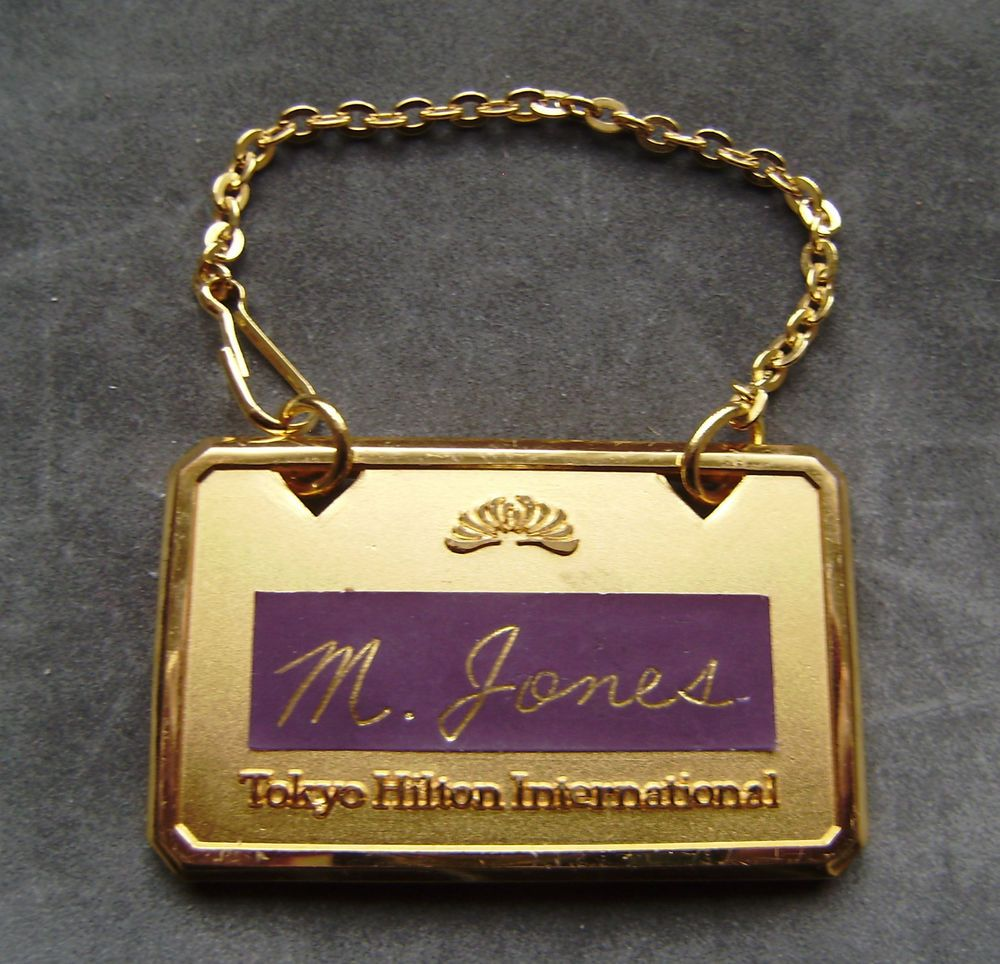 Rolled gold luxury luggage tag from worlds top hotel tokyo hilton