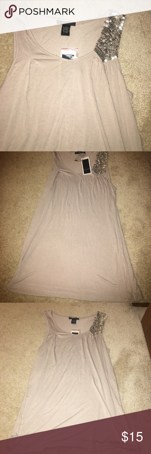 New w/tags Design history taupe tank large New w/tags Design history taupe tank large .  100% viscose. Sequin detail. Beautiful tank top. Last picture is without flash Design History Tops Tank Tops
