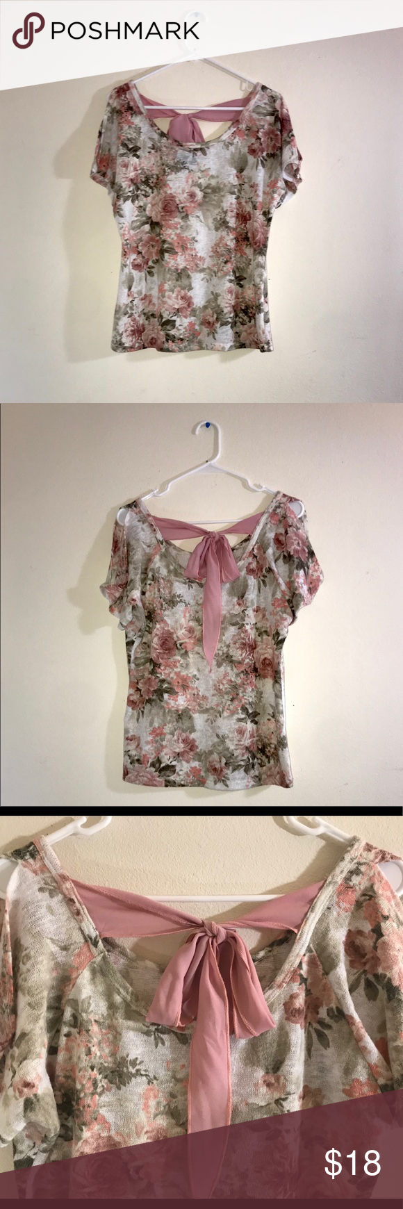 NAIF Short Sleeve Floral Top NAIF Brand Shirt Size L Short Sleeves w/ narrow rolled cap Soft White w/ Floral Print Scoop neck in front with lower scoo…