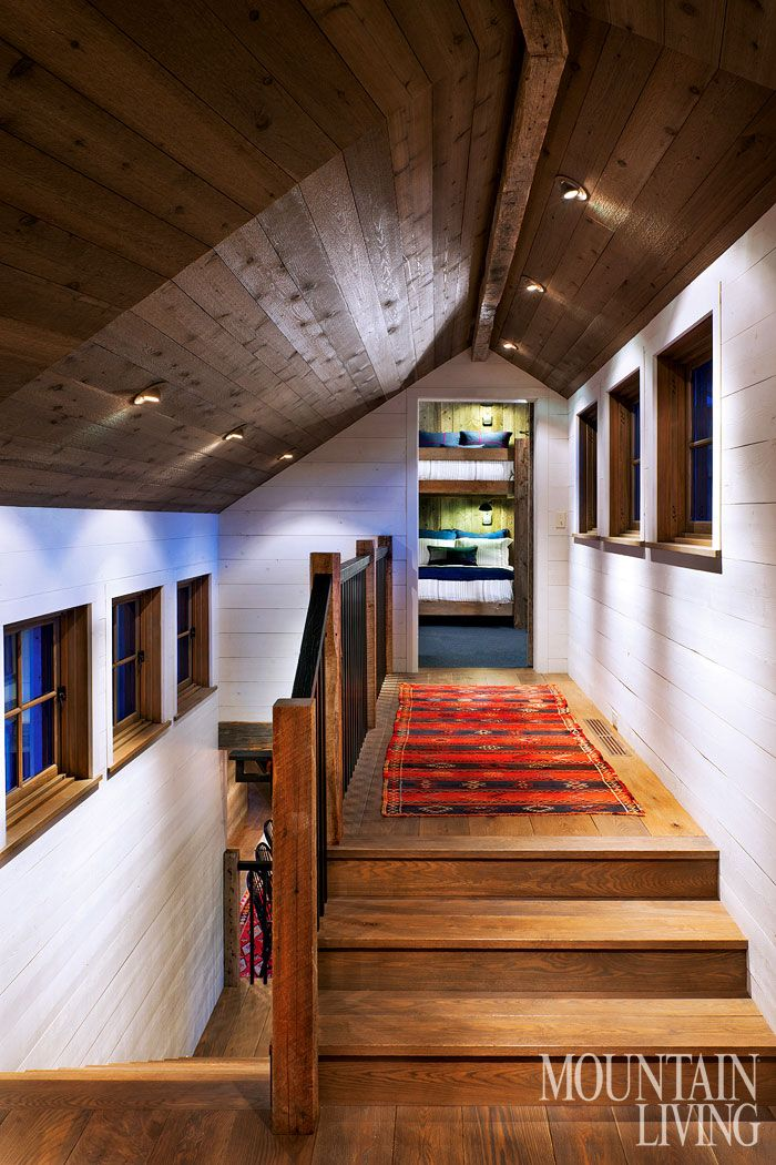 love the white painted beams as contrast to the dark wood