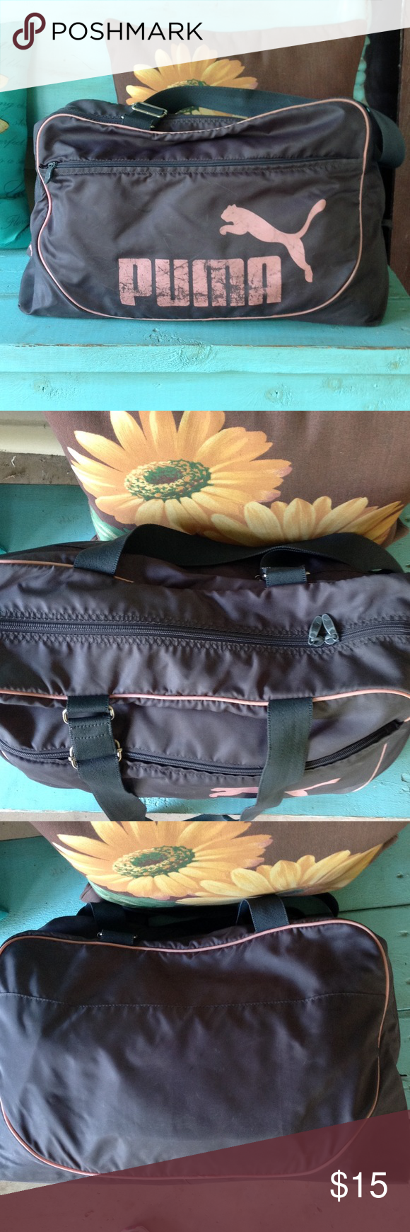 Puma duffle bag. Puma duffle bag. Measures 19 inches long and is 16 inches tall.,it is in used condition see pics no holes,adjustable straps,inside zippered compartment. Puma Bags