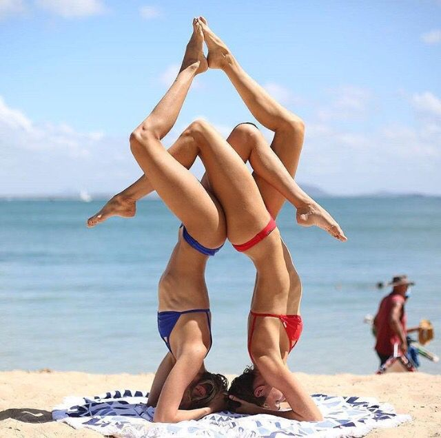 Couples acro. Partner acro. Yoga on the beach.