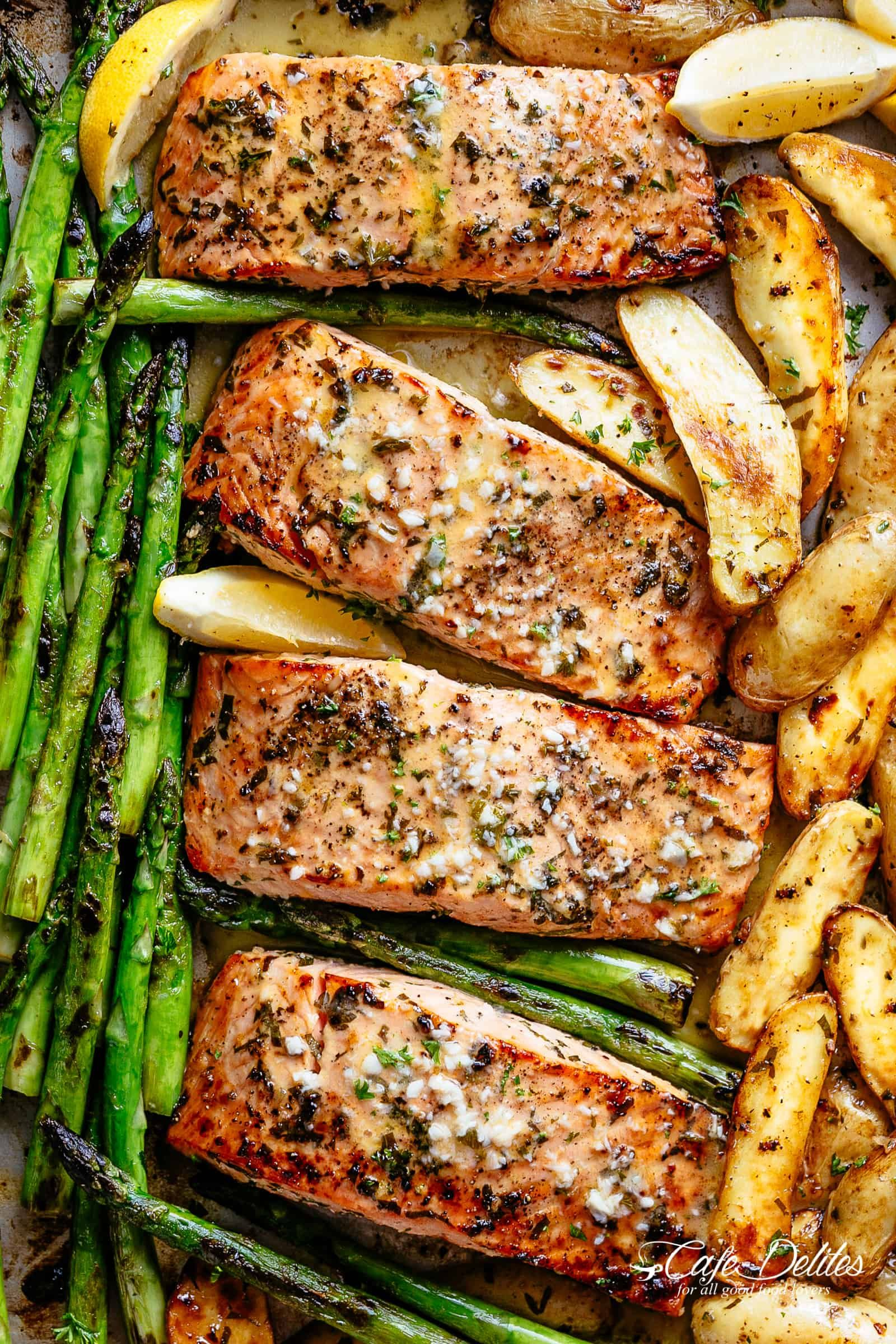 Sheet Pan Garlic Butter Baked Salmon with crispy potatoes, asparagus and a garlic butter sauce with a touch of lemon | cafedelites.com