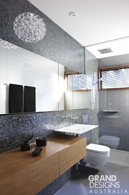 whats trending in bathroom design grey and black bathroom detailing with timber highlights as shown in clovelly house from grand designs australia - Small Bathroom Designs Australia