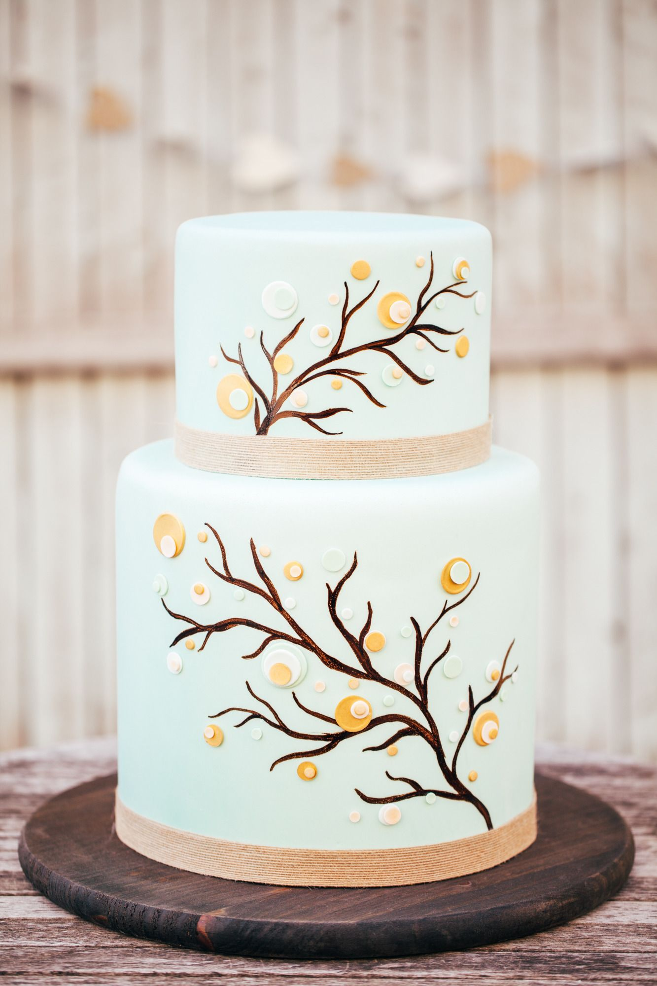Playful wedding cake | Read More: http://www.stylemepretty.com/2014/08/18/diy-gold-heart-arrows-rustic-whimsical-wedding-inspiration/ | Photography: Studio Finch - www.studiofinch.com