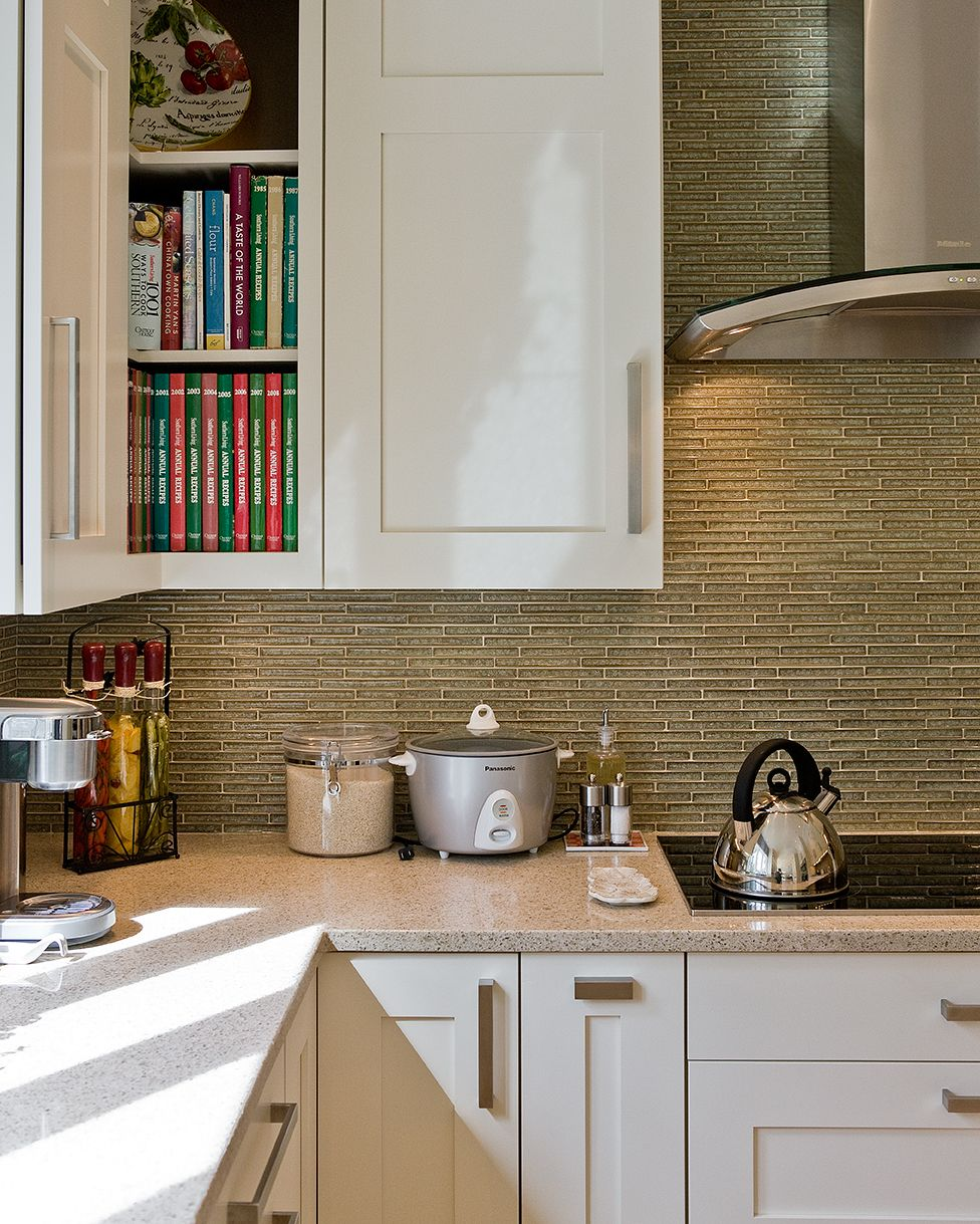 backsplash: olive green, crackled glass matchstick tiles from