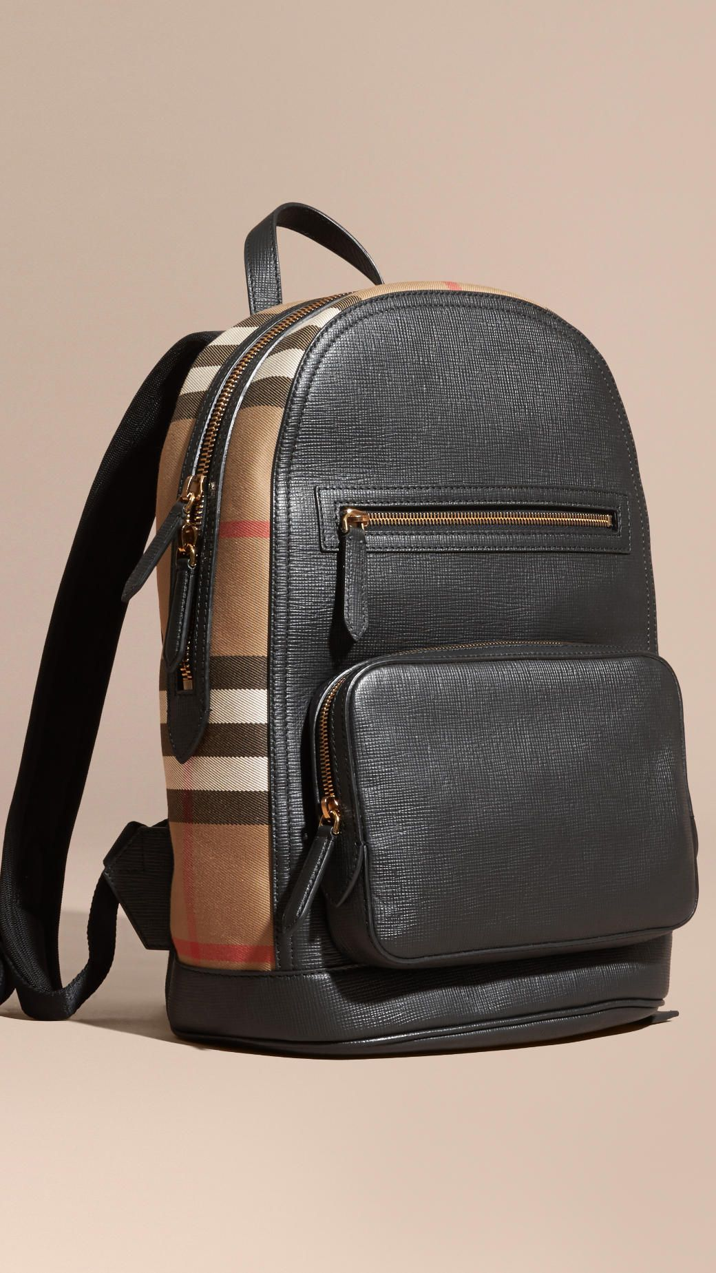 77b51cfe9f94 A backpack shaped in textured leather and English-woven House check.  Burberry