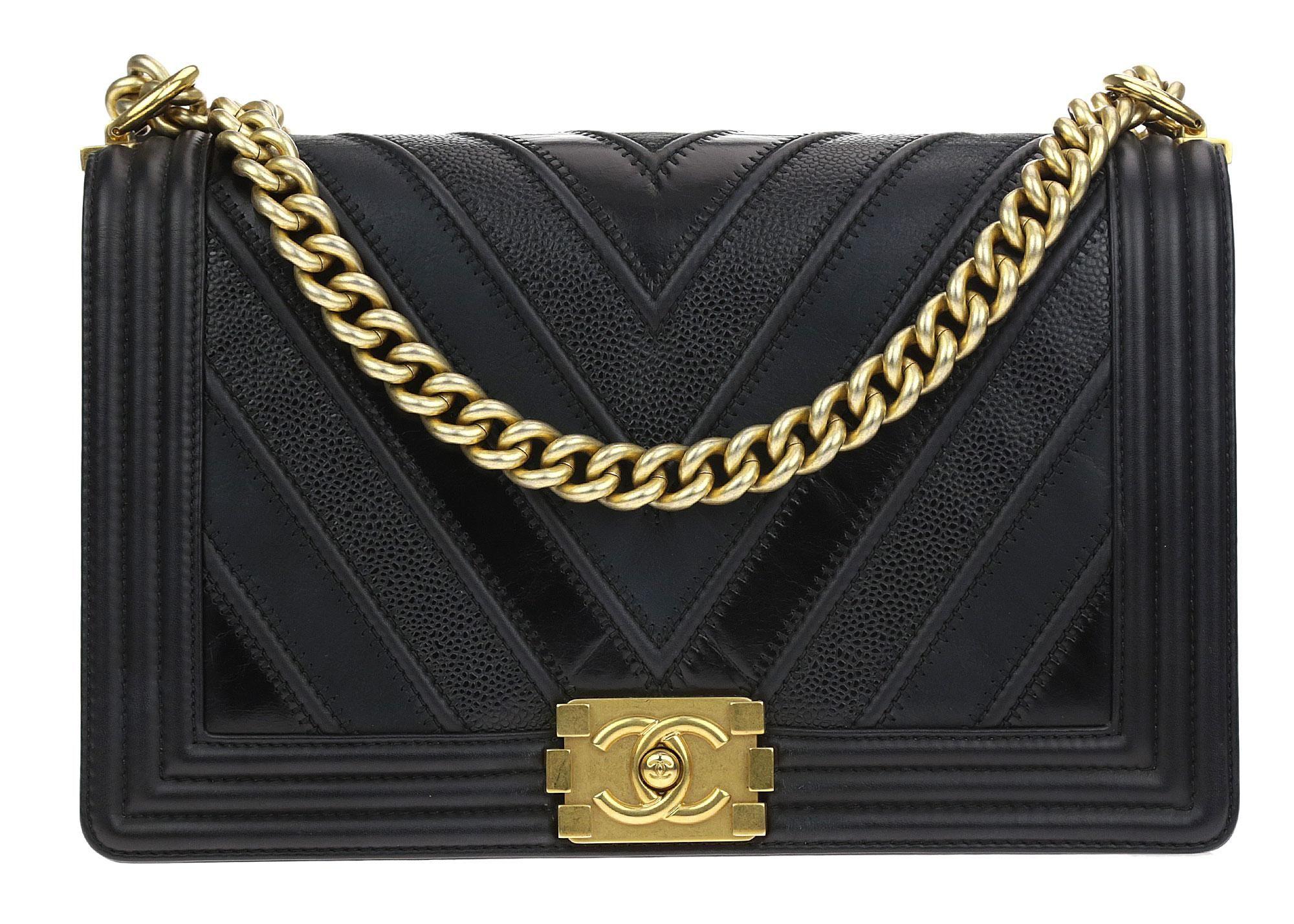 7da4f121b0b8 Chanel Caviar Suede Calfskin Chevron New Medium Boy Shoulder Bag. Get one  of the hottest styles of the season! The Chanel Caviar Suede Calfskin  Chevron New ...