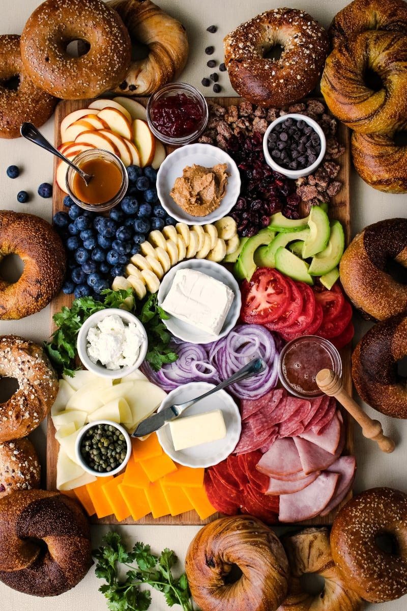 The Ultimate Bagel Bagel Brunch Board featuring New Yorker Bagels is loaded with bagel toppings galore!  A variety of spreads, fruits, vegetables, cheeses, meats, and a few unique toppings make this bagel board a showstopper. #breakfast #brunch #bagels #ad #charcuterieboard