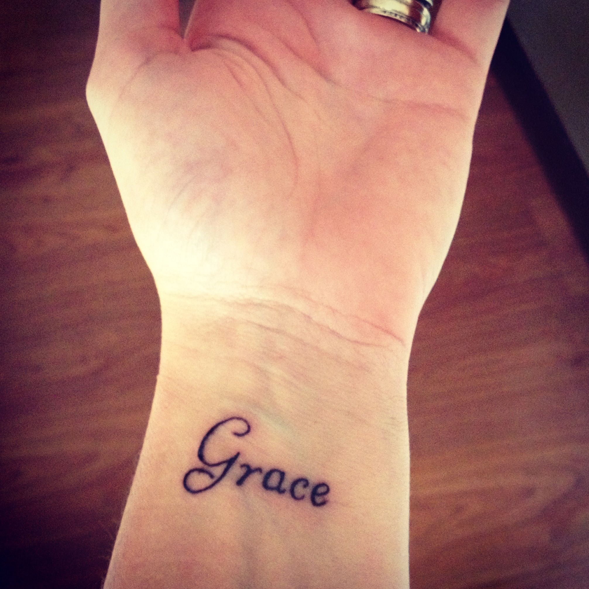 Grace Wrist Tattoo Thinking About It In White With A Different Script Word Tattoos Grace Tattoos Love Wrist Tattoo