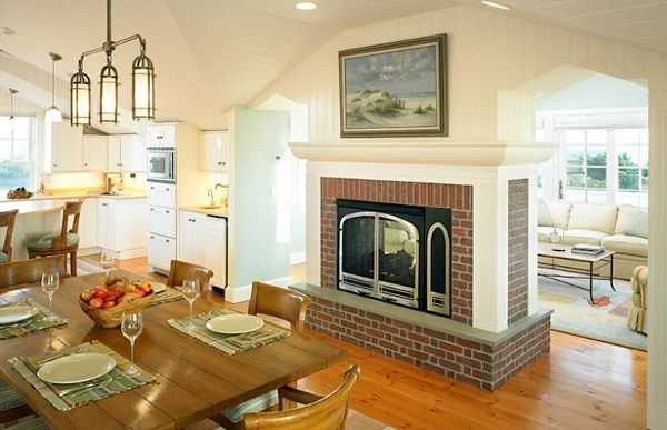 A House In Nantucket Designed With An Upside Down Floorplan Freestanding Fireplace Brick Fireplace Fireplace Built Ins