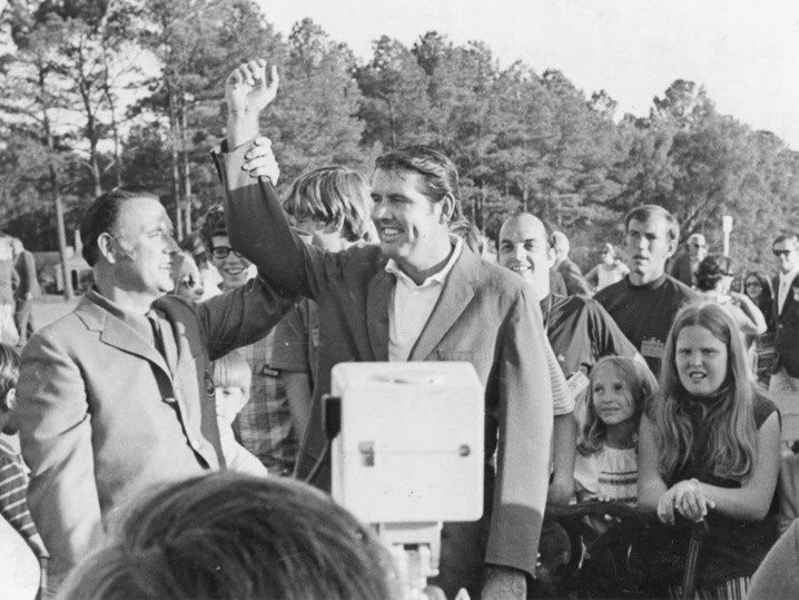 Billy Casper holds Masters winner Charles Coody's hand at the 1971 ...