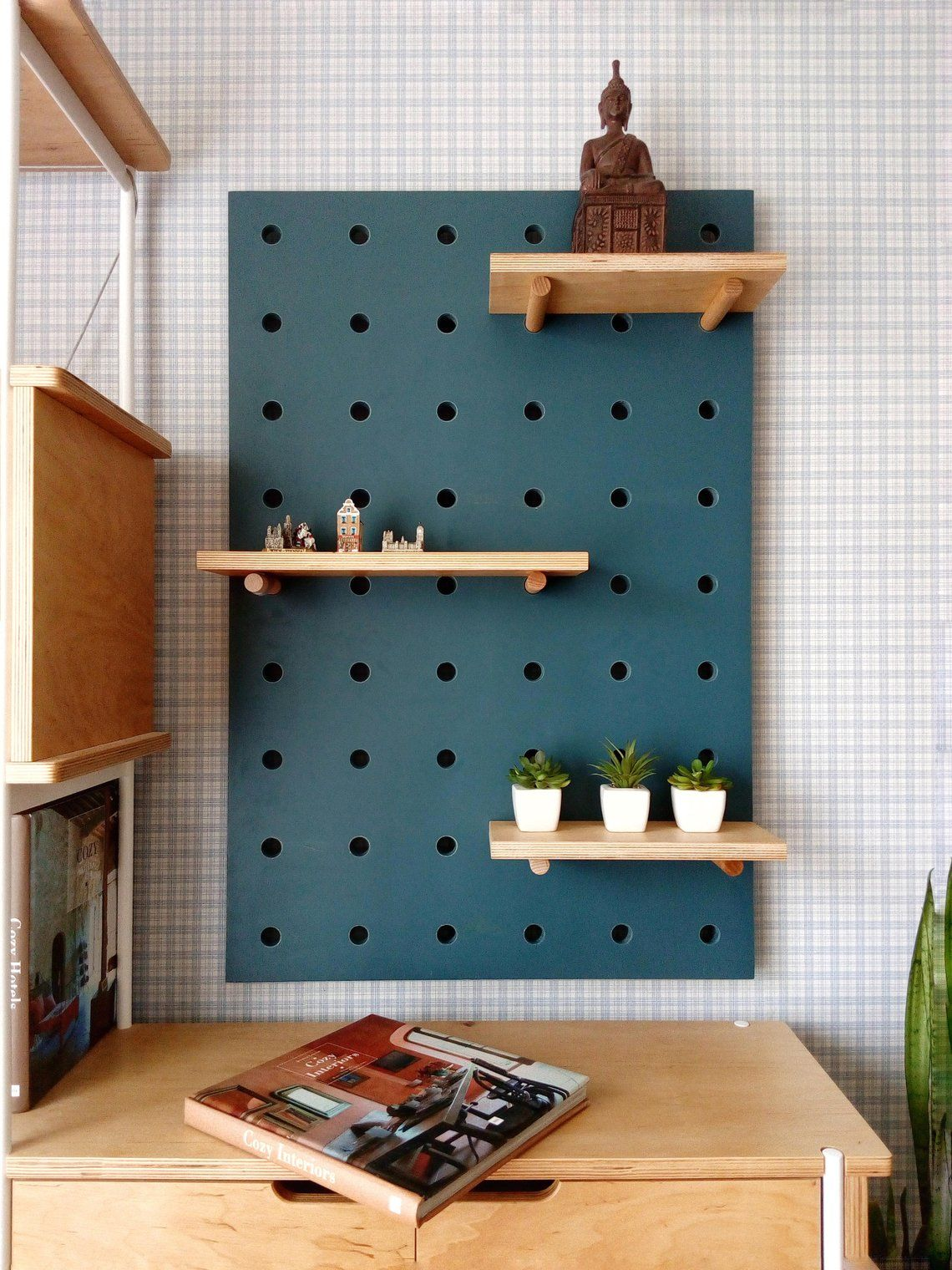 Photo of Pegboard organizer, plywood peg board shelf.