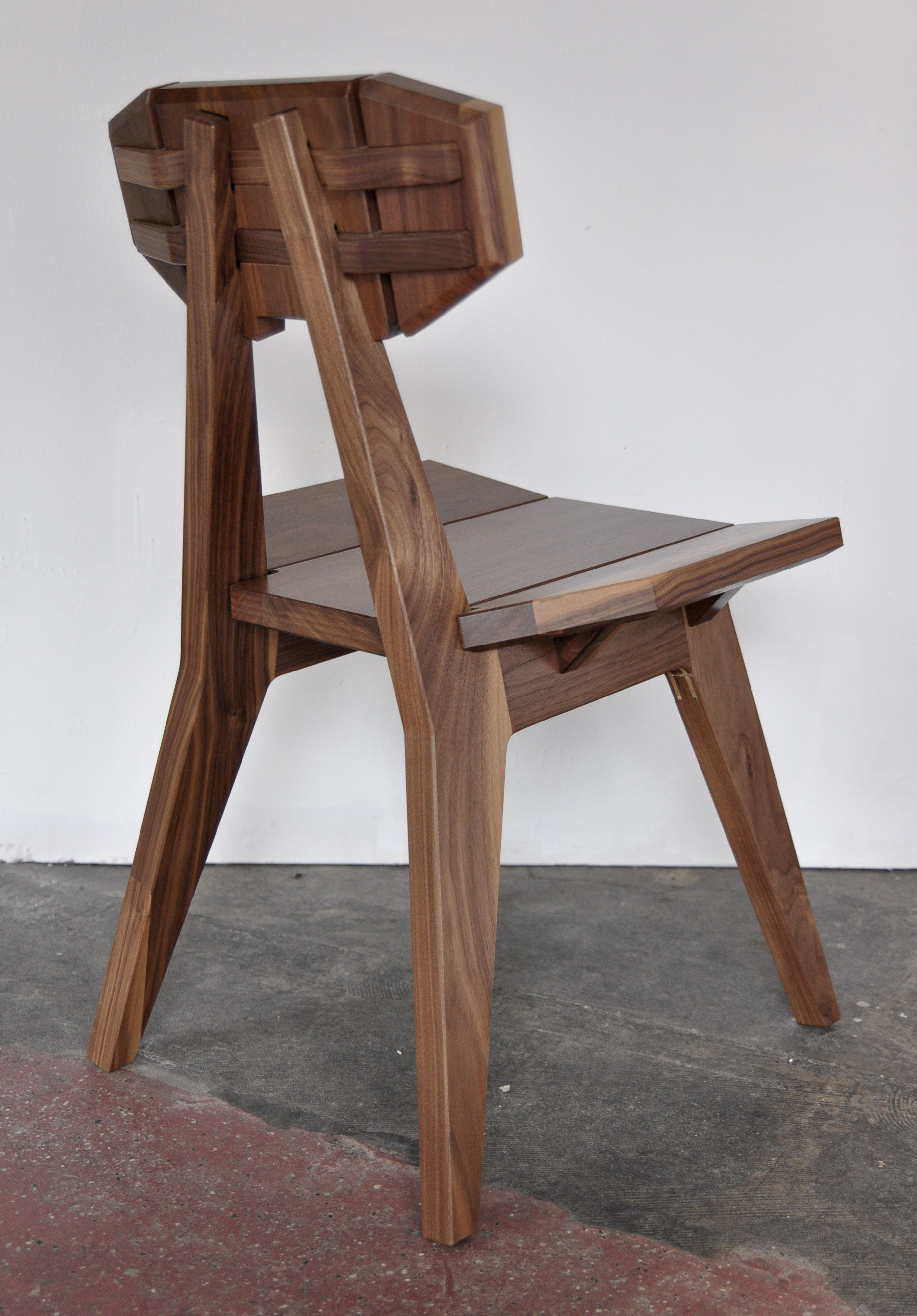 Faceted low back chair in walnut by vincentedwardsdesign Made mostly with a CNC router