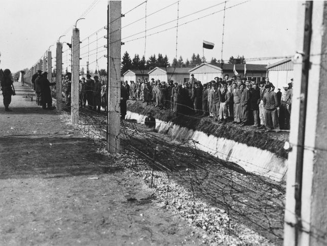 To the barbed wire fence surrounding dachau