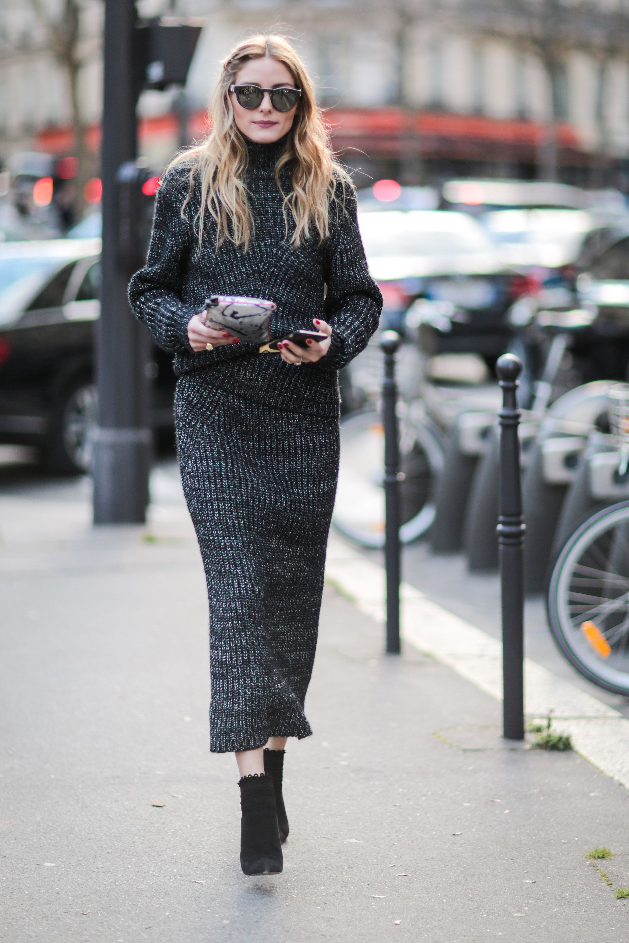 Olivia scored major points for style and comfort in this two-piece knit set while out for the Roland Mouret...
