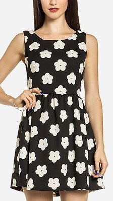 Daisy Fit and Flare Dress So cute! Maybe if it was longer lol