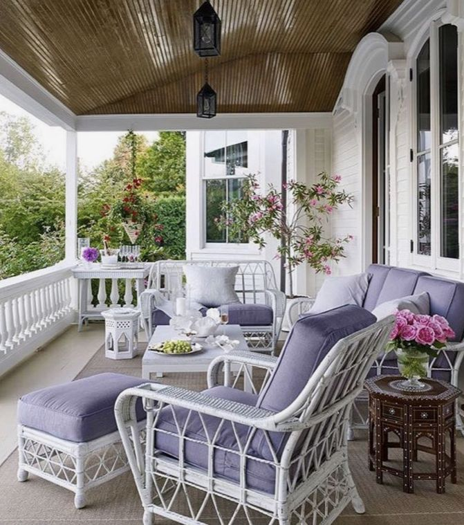 outdoor fireplace porch patio chairs flowers art