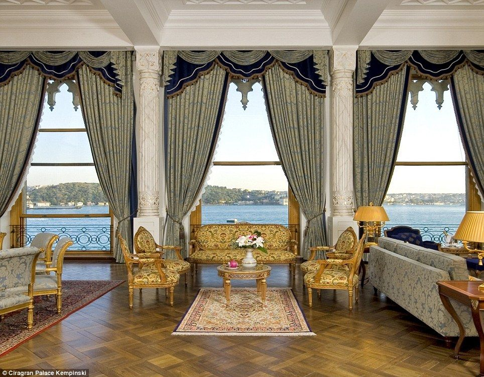 Classic Furniture Carpets And Curtains Surround The Sitting Room Which Leads Onto A Balcony