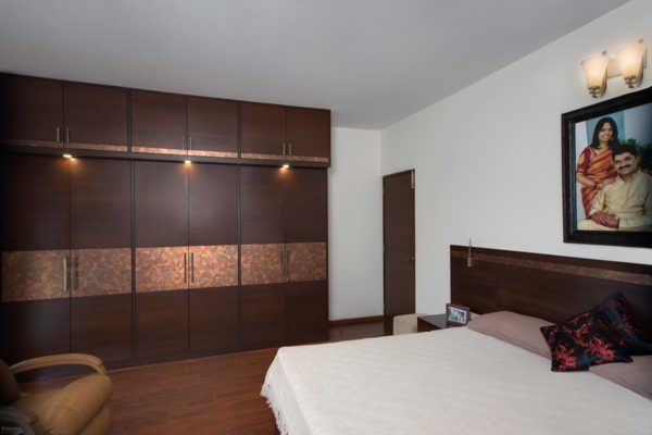 Designing a wardrobe that is in sync with the d cor of for Bedroom designs indian