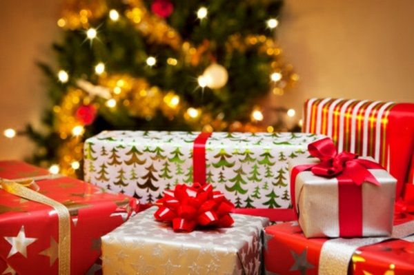 group of christmas gifts in front of tree