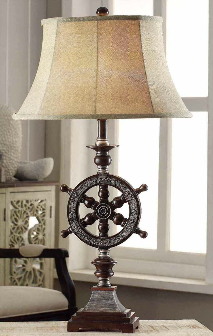 Perfect sea captain style ships wheel table lamp get the look create a captivating nautical style with this 33 inch tall resin ships wheel table lamp an oval burlap shade completes this maritime look geotapseo Image collections