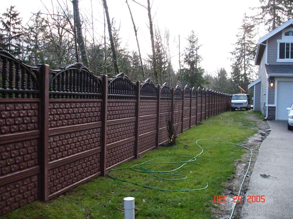 This Is A Poured Concrete Fence Isn T It Amazing It Blocks Traffic Noise Really Well I Think It Is Quite Pretty Backyard Landscaping Backyard Modern Fence