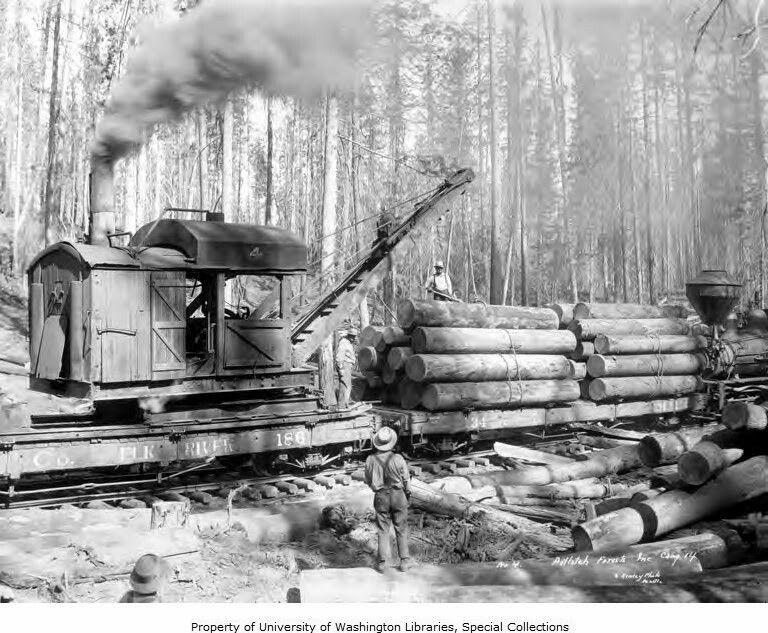 Elk River rail crane loading cars Potlatch forest. Elk