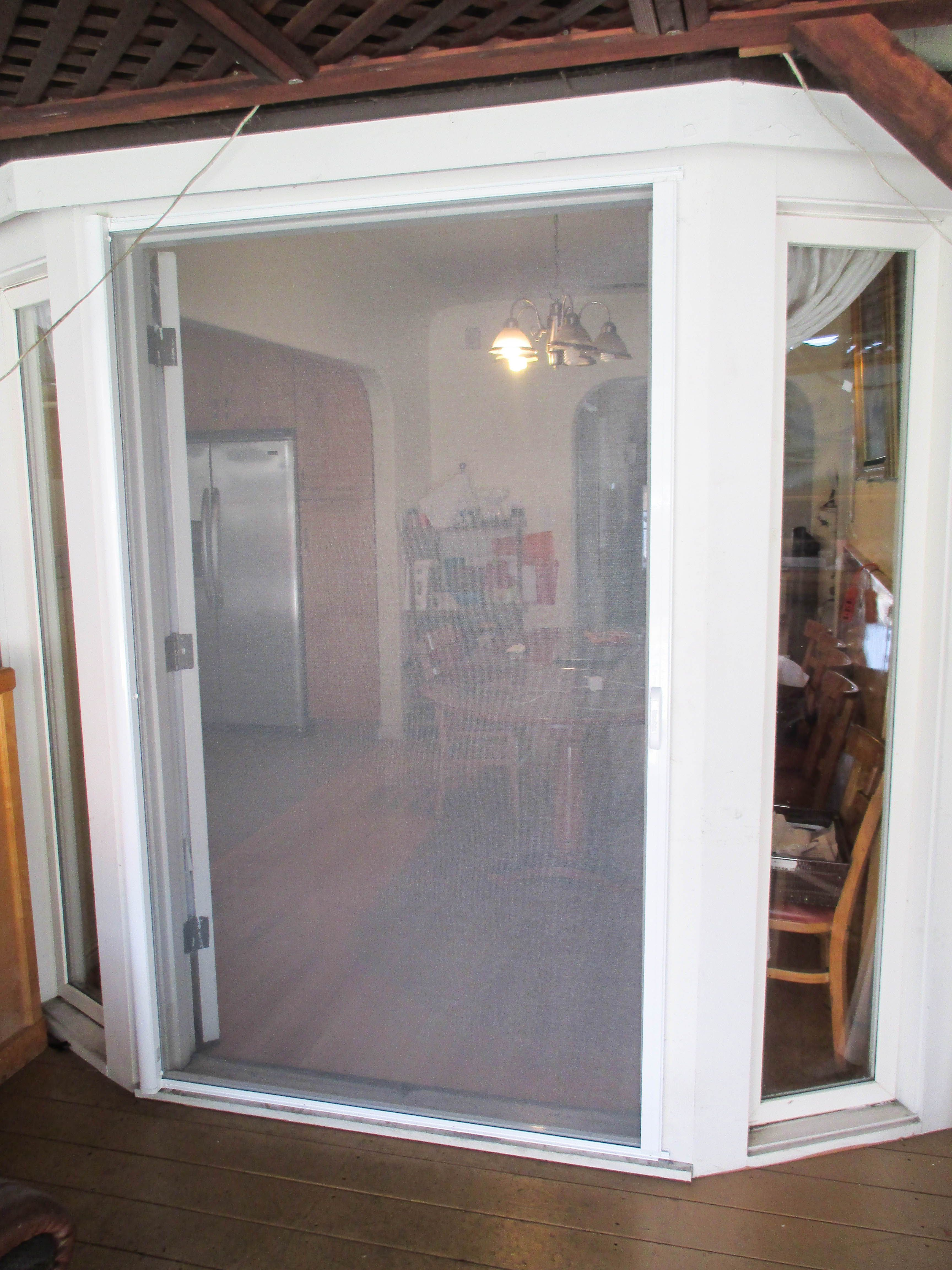 Check out this whiteframed single Retractable Screen Door