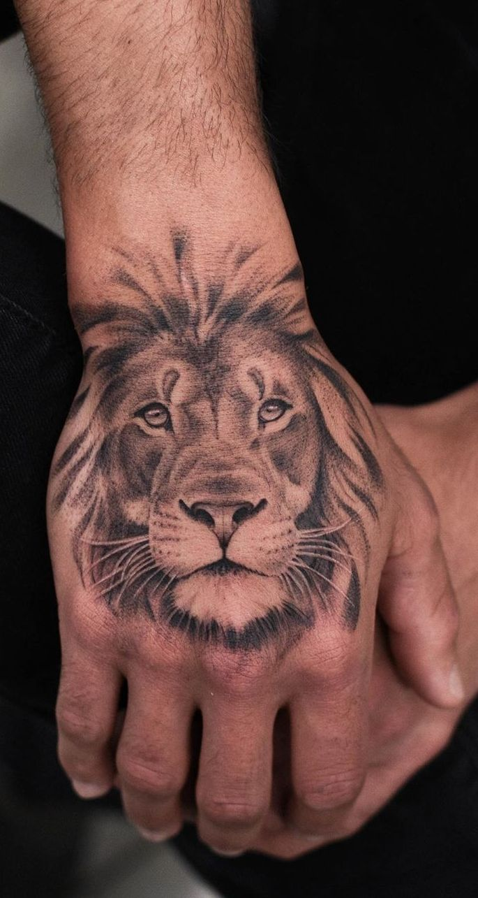 50 Eye Catching Lion Tattoos That Ll Make You Want To Get Inked Lion Hand Tattoo Lion Head Tattoos Hand Tattoos