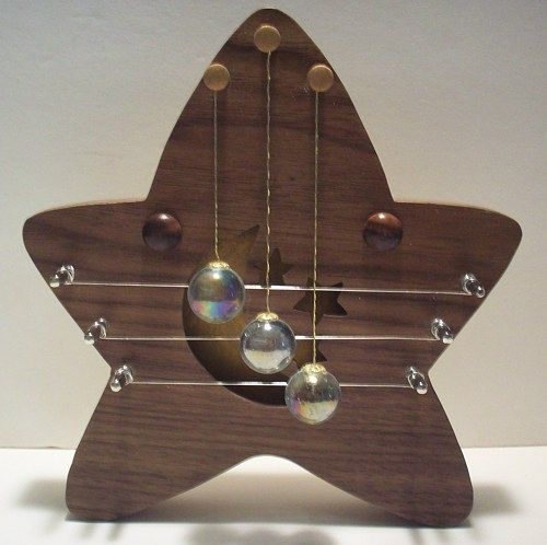 A star is born. This is my newest addition to the door harp ...