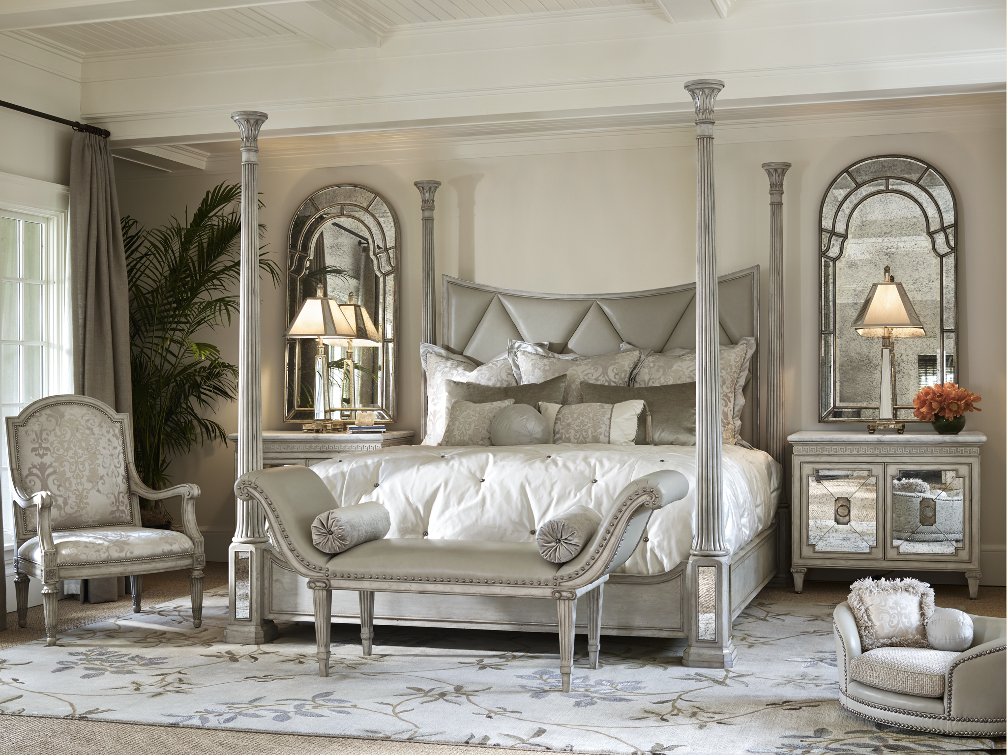 The Ionia four poster bed with diamond tufted upholstery and ...