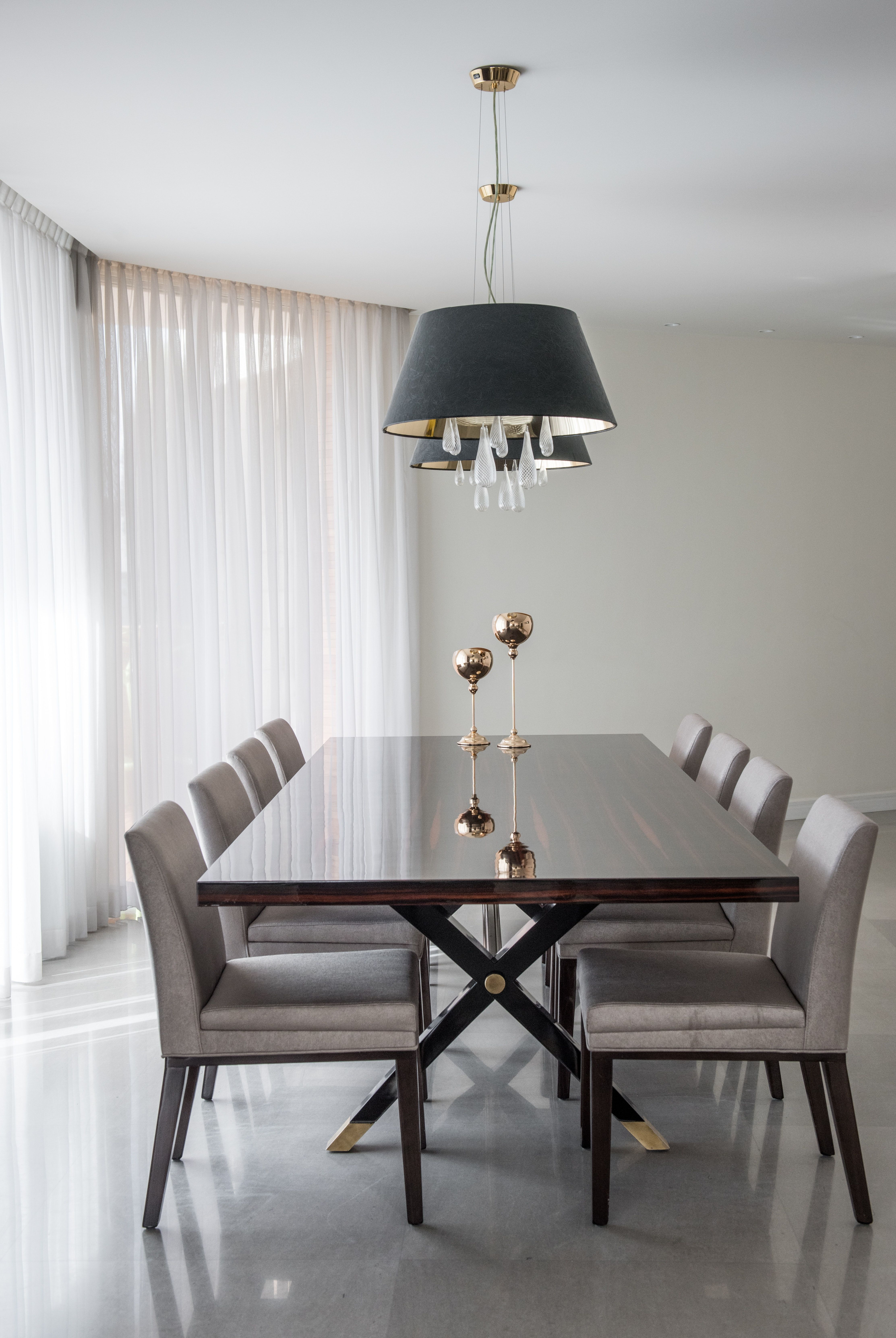 An Elegant And Minimalist High Gloss Ebony Dining Table With Brass