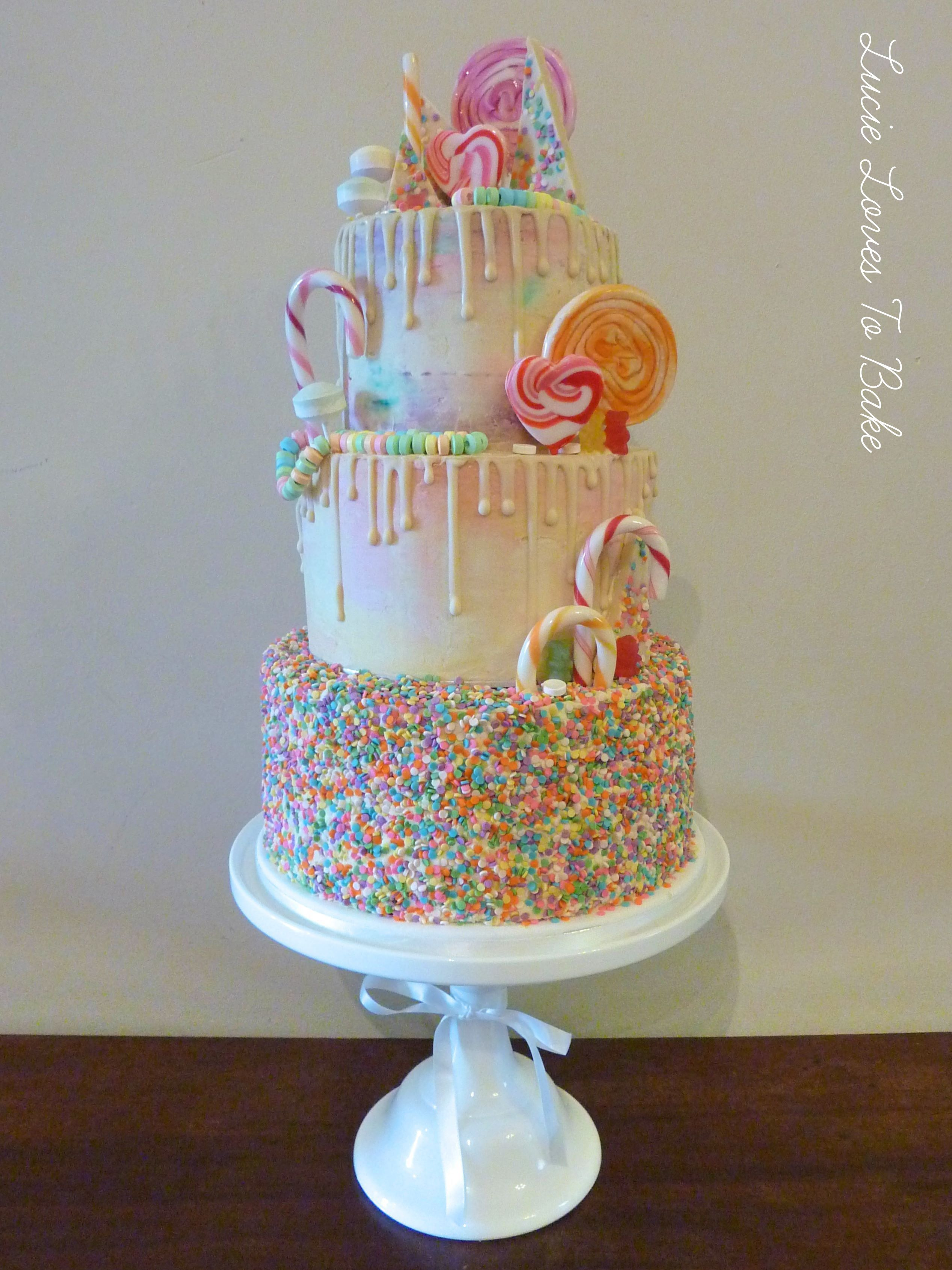 Vegan Sprinkle Rainbow Drip Cake Decorated With Sweets Lollipops